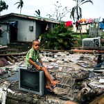 On 26 February 2016, Uraia, 7, sitting on a TV set on the remains of his home, that was destroyed by Cyclone Winston. Uraia's house is located a few metres from the shoreline, where there were strong storm surges at the height of the cyclone. Category 5 Tropical Cyclone Winston made landfall in Fiji on Saturday 20 February, continuing its path of destruction into Sunday 21 February. A state of natural disaster and a nationwide curfew had been declared by the Government of Fiji earlier in the evening. In the wake of Cyclone Winston, UNICEF's main concern is for children, pregnant women and breastfeeding mothers across Fiji. Little is yet known about the status of communities living on the outer islands of Fiji that were directly under the eye of Tropical Cyclone Winston- as communications remain down for many. The Fijian Government is rapidly working to assess the overall situation in order to pinpoint the critical needs. The Fijian Government has declared a state of natural disaster for the next 30 days and has initiated the clean-up process by clearing the huge amounts of debris scattered everywhere. UNICEF staff members are standing by to assist as required.